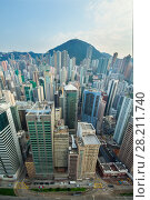 Купить «Skyscrapers and tall buildings in business area and mountain far away in Hong Kong, China, view from China Merchants Tower», фото № 28211740, снято 31 августа 2015 г. (c) Losevsky Pavel / Фотобанк Лори