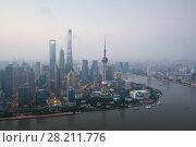 Купить «Shanghai pudong lujiazui skyscrapers at morning in fog, top view», фото № 28211776, снято 15 августа 2015 г. (c) Losevsky Pavel / Фотобанк Лори