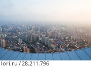 Купить «Shanghai in fog and edge of roof of tall building at early morning during sunrise, view from White Magnolia Plaza», фото № 28211796, снято 15 августа 2015 г. (c) Losevsky Pavel / Фотобанк Лори