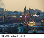 Купить «Kremlin wall, Spassky Tower and St Basil Cathedral in Moscow, Russia», фото № 28211816, снято 15 октября 2019 г. (c) Losevsky Pavel / Фотобанк Лори