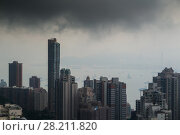 Купить «Tall skyscrapers, sea shore with ships, dark clouds in business area in mist in Hong Kong, China, view from Queen Garden», фото № 28211820, снято 4 сентября 2015 г. (c) Losevsky Pavel / Фотобанк Лори