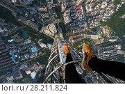 Купить «Skyscrapers, buildings roofs, roofer legs in Hong Kong city, China, aerial view», фото № 28211824, снято 16 августа 2015 г. (c) Losevsky Pavel / Фотобанк Лори