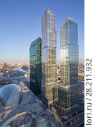 Купить «MOSCOW - MAR 26, 2016: Central core, Empire, Capital City Tower in Moscow International Business Center. Underground part of the Core includes 3 metro station», фото № 28211932, снято 26 марта 2016 г. (c) Losevsky Pavel / Фотобанк Лори