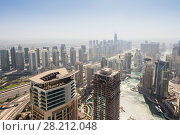 Купить «City road, skyscrapers and watercourse at sunny day in Dubai, UAE», фото № 28212048, снято 7 января 2017 г. (c) Losevsky Pavel / Фотобанк Лори