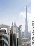 Купить «DUBAI, UAE - JAN 8, 2017: Burj Khalifa, Central Park Residential Tower, Dubai ranked fifth in Emporis ranking of world cities with largest number of skyscrapers», фото № 28212064, снято 8 января 2017 г. (c) Losevsky Pavel / Фотобанк Лори