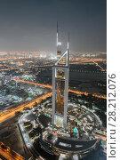 Купить «DUBAI, UAE - JAN 8, 2017: Jumeirah Emirates Towers Hotel at night, At structural height of 309 m», фото № 28212076, снято 8 января 2017 г. (c) Losevsky Pavel / Фотобанк Лори