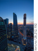 Купить «MOSCOW - JUN 1, 2015: Mercury Tower, Federation Tower in International Business Center, Investments in Moscow International Business Center was approximately 12 billion dollars», фото № 28212192, снято 1 июня 2015 г. (c) Losevsky Pavel / Фотобанк Лори