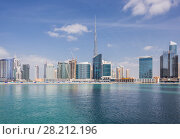 Купить «Artificial Site Dubai Creek, Burj Khalifa and Business bay at sunny day in Dubai, UAE», фото № 28212196, снято 15 января 2017 г. (c) Losevsky Pavel / Фотобанк Лори