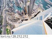 Купить «DUBAI, UAE - JAN 15, 2017: Skyscrapers in Dubai Marina area and many boats, view from Marina 101», фото № 28212212, снято 15 января 2017 г. (c) Losevsky Pavel / Фотобанк Лори