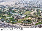 Купить «Emirates Golf Club and residential areas far away in Dubai, UAE, top view», фото № 28212228, снято 15 января 2017 г. (c) Losevsky Pavel / Фотобанк Лори