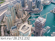 Купить «Dubai Marina Canal among hotels in Dubai Marina area and highway in Dubai, UAE», фото № 28212232, снято 15 января 2017 г. (c) Losevsky Pavel / Фотобанк Лори