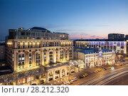 MOSCOW - JULY 1, 2014: (long exposure) Tverskaya street (main street) of Moscow. Ritz-Carlton hotel at evening. Редакционное фото, фотограф Losevsky Pavel / Фотобанк Лори
