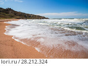 Купить «Waterside of sea, foam, blue sky, beach and rocks at summer sunny day», фото № 28212324, снято 21 августа 2014 г. (c) Losevsky Pavel / Фотобанк Лори