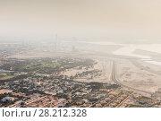 Купить «Residential area, buildings, lakes arnd desert in fog far away in Dabai, UAE», фото № 28212328, снято 21 января 2017 г. (c) Losevsky Pavel / Фотобанк Лори