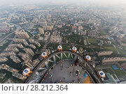 Купить «GUANGZHOU, CHINA - AUG 21, 2015: Observation deck of Canton Tower and city panorama, This is second tallest TV tower in world», фото № 28212364, снято 21 августа 2015 г. (c) Losevsky Pavel / Фотобанк Лори