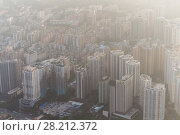 Купить «Residential area in modern Guangzhou city in mist, China, top view», фото № 28212372, снято 21 августа 2015 г. (c) Losevsky Pavel / Фотобанк Лори