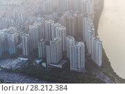Купить «Guangzhou residential area near Zhujiang river in fog, China», фото № 28212384, снято 21 августа 2015 г. (c) Losevsky Pavel / Фотобанк Лори