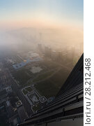 Купить «SHENZHEN, CHINA - AUG 25, 2015: Rooftop (of Ping An Finance Centre) at morning cityscape in fog», фото № 28212468, снято 25 августа 2015 г. (c) Losevsky Pavel / Фотобанк Лори