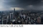 Купить «Skyscrapers and dark stormy sky, view from Panglin Plaza, Shenzhen, China», фото № 28212528, снято 27 августа 2015 г. (c) Losevsky Pavel / Фотобанк Лори