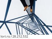 Купить «Legs og roofer inside top of crane on skyscraper under construction in clouds», фото № 28212532, снято 10 августа 2015 г. (c) Losevsky Pavel / Фотобанк Лори