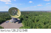 Купить «MOSCOW - JUL 25, 2015: Antenna TNA 1500 of radio telescope RT-64 Bear Lakes among forest at summer sunny day. Aerial view», фото № 28212548, снято 25 июля 2015 г. (c) Losevsky Pavel / Фотобанк Лори