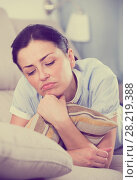 Купить «Portrait of gloomy young woman with pillow», фото № 28219388, снято 2 июня 2017 г. (c) Яков Филимонов / Фотобанк Лори