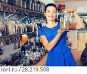 Купить «adult female choosing natural dried herbs sold by weight in eco shop», фото № 28219508, снято 13 июня 2017 г. (c) Яков Филимонов / Фотобанк Лори