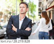 Купить «Disappointed man in quarrel with girlfriend», фото № 28219828, снято 11 апреля 2017 г. (c) Яков Филимонов / Фотобанк Лори