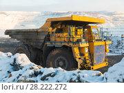 Купить «Large quarry dump truck. Loading the rock in dumper. Loading coal into body truck. Production useful minerals. Mining truck mining machinery, to transport coal from open-pit as the Coal Production.», фото № 28222272, снято 30 января 2018 г. (c) Сергей Тимофеев / Фотобанк Лори