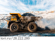 Купить «Large quarry dump truck. Loading the rock in dumper. Loading coal into body truck. Production useful minerals. Mining truck mining machinery, to transport coal from open-pit as the Coal Production.», фото № 28222280, снято 30 января 2018 г. (c) Сергей Тимофеев / Фотобанк Лори