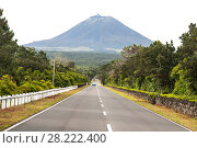 Купить «View of the Pico volcano in a light haze, Pico Island, Azores», фото № 28222400, снято 5 мая 2012 г. (c) Юлия Бабкина / Фотобанк Лори