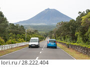 Купить «Two cars on the highway against the backdrop of the Pico volcano, Azores», фото № 28222404, снято 5 мая 2012 г. (c) Юлия Бабкина / Фотобанк Лори