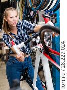 Купить «Portrait of active girl posing with bicycle», фото № 28227024, снято 13 сентября 2017 г. (c) Яков Филимонов / Фотобанк Лори