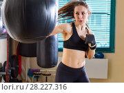 Купить «Woman boxer in time of workout», фото № 28227316, снято 21 марта 2018 г. (c) Владимир Мельников / Фотобанк Лори