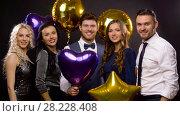 Купить «happy friends with golden and violet balloons», видеоролик № 28228408, снято 7 марта 2018 г. (c) Syda Productions / Фотобанк Лори