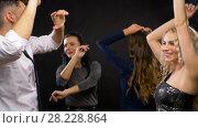 Купить «happy friends dancing at party or disco», видеоролик № 28228864, снято 7 марта 2018 г. (c) Syda Productions / Фотобанк Лори
