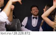 Купить «happy friends dancing at party or disco», видеоролик № 28228872, снято 7 марта 2018 г. (c) Syda Productions / Фотобанк Лори
