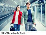 Купить «travellers moving through station», фото № 28229508, снято 31 марта 2020 г. (c) Яков Филимонов / Фотобанк Лори