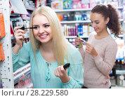 Купить «Girls applying mascara near mirror», фото № 28229580, снято 22 апреля 2018 г. (c) Яков Филимонов / Фотобанк Лори