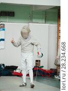 Купить «Teenager young fencer in white costume and protective mask», фото № 28234668, снято 26 марта 2018 г. (c) Константин Шишкин / Фотобанк Лори