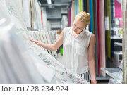 Купить «Beautiful housewife buying white curtains in home decor furnishings store.», фото № 28234924, снято 12 ноября 2019 г. (c) Matej Kastelic / Фотобанк Лори