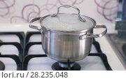 Купить «Boiling food while cooking», видеоролик № 28235048, снято 16 марта 2018 г. (c) Илья Шаматура / Фотобанк Лори