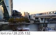 Купить «Moscow, Russia - November 2. 2017. Skyscrapers of Moscow City and Bagration Bridge at sunset.», видеоролик № 28235132, снято 2 ноября 2017 г. (c) Володина Ольга / Фотобанк Лори