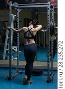 Woman with the barbell in the gym. Стоковое фото, фотограф Владимир Мельников / Фотобанк Лори