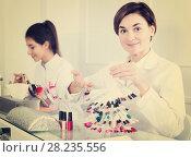 Купить «Manicurist demonstrating her workplace», фото № 28235556, снято 2 февраля 2017 г. (c) Яков Филимонов / Фотобанк Лори