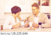 Купить «Man and woman with coffee», фото № 28235644, снято 17 октября 2018 г. (c) Яков Филимонов / Фотобанк Лори