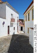 Купить «Cozy narrow paved streets with white houses inside the old city walls of Mertola. Beja. Portugal», фото № 28238056, снято 30 июня 2016 г. (c) Serg Zastavkin / Фотобанк Лори