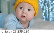 Купить «Cute baby in yellow hat», видеоролик № 28239220, снято 28 марта 2018 г. (c) Илья Шаматура / Фотобанк Лори