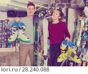 Купить «Woman and man are demonstrating their choice of ski boots», фото № 28240088, снято 31 июля 2017 г. (c) Яков Филимонов / Фотобанк Лори