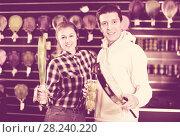 Купить «Sporty couple is demonstraiting modern racket and balls for padel», фото № 28240220, снято 7 февраля 2018 г. (c) Яков Филимонов / Фотобанк Лори